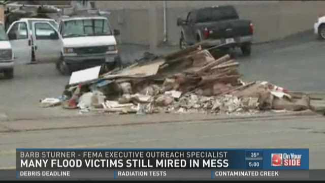 Many flood victims still mired in mess