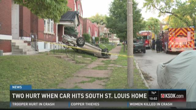 Two hurt after car hits south STL home