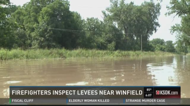 Firefighters inspect levees near Winfield