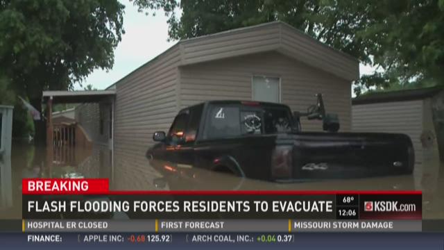 Flash flooding forces residents to evacuate