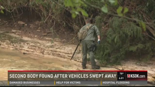 Second body found after vehicles swept away