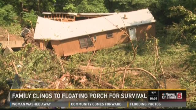 Family clings to floating porch for survival