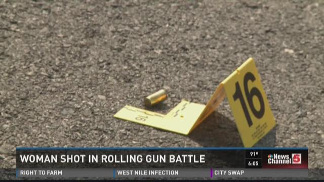 Woman shot in rolling gun battle