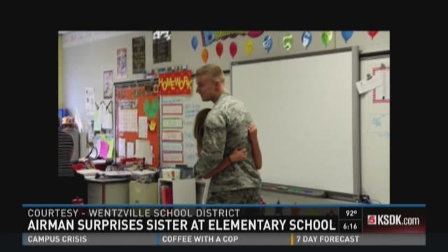 Airman surprises sister at elementary school