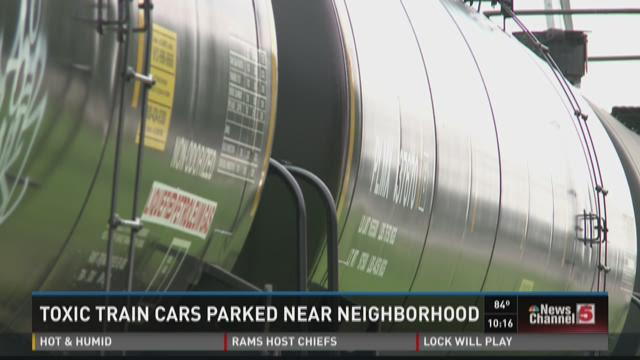 Toxic train cars parked near neighborhood