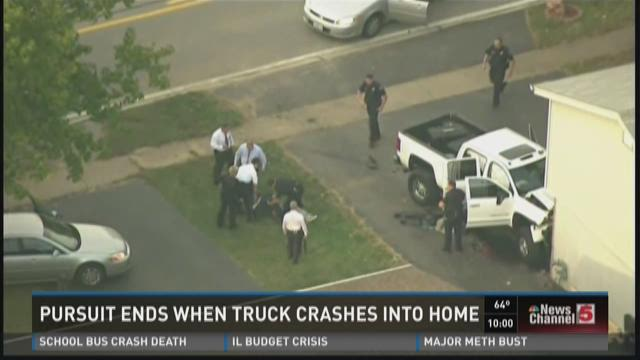 Pursuit ends when truck crashes into home