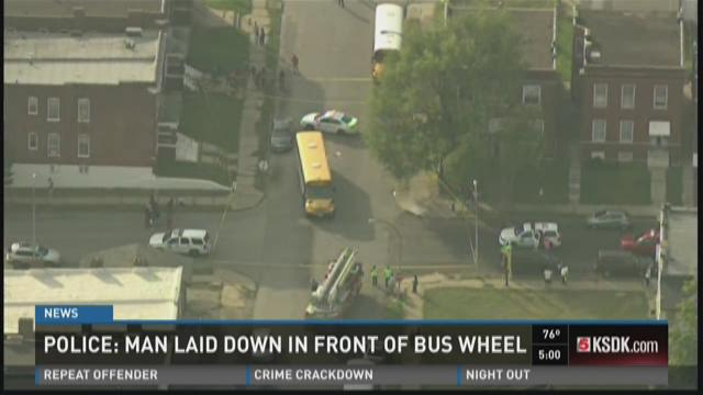 Police: Man laid down in front of bus wheel